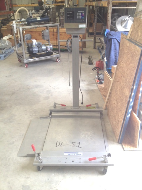 Used METTLER Stainless Steel portable Floor Scale. Model JAGXTREME. Fact. no. JXHA1000000. S/N 5505651-5MG.  Has one fold down ramp. From Pharmaceutical plant.