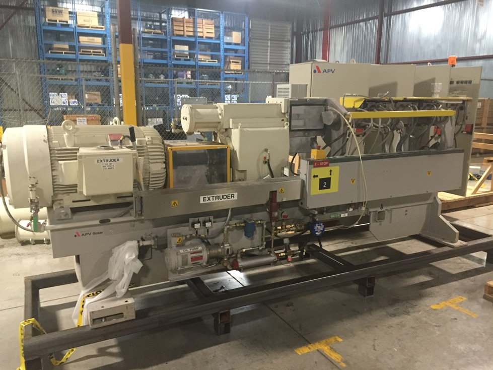 ***SOLD*** used APV Baker Perkins Model MP80 Twin Screw mixer/extruder. 80 mm Screws with 25:1 L/D ratio. Typical Outputs 1500-2900 (kg/h).  (6) Zone Electrically heated, water cooled.  Max operating temp. 200 deg.C. (392 deg.F.)  Driven by a Reliance 225 HP, 460 volt Inverter Duty motor. Variable speed from 0-600 rpm. Control cabinet included.