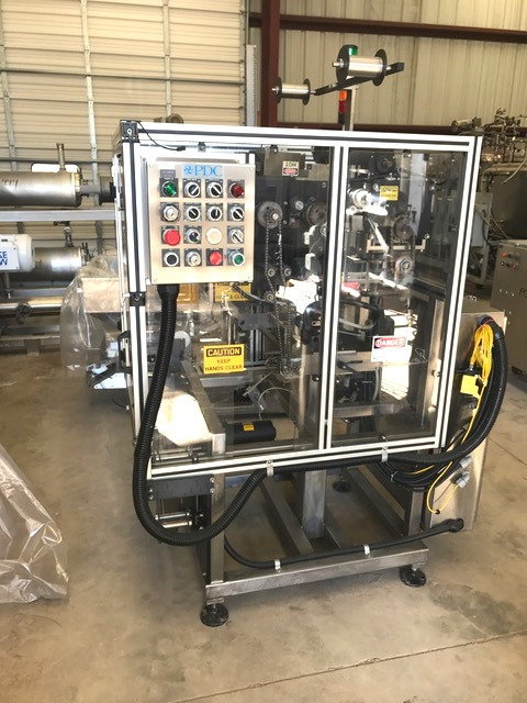 ***SOLD*** Used PDC 65-E Shrink Sealer Tamper Evident Band Applicator. Ideal for mid-level speed tamper evident banding or shrink sleeve applicator. Output: up to approximately 200 containers per minute, depending on container and band size. Tamper evident banding: Band diameter range:  .375 to 3.25 inches.  Band height range: .625 to 8 inches. Line speed:  50 to 200 containers per minute. Shrink sleeve labeling: Sleeve diameter range: .375 to 3.25 inches. Sleeve height range:  .625 to 8 inches. Line speed:  50 to 175 containers per minute.