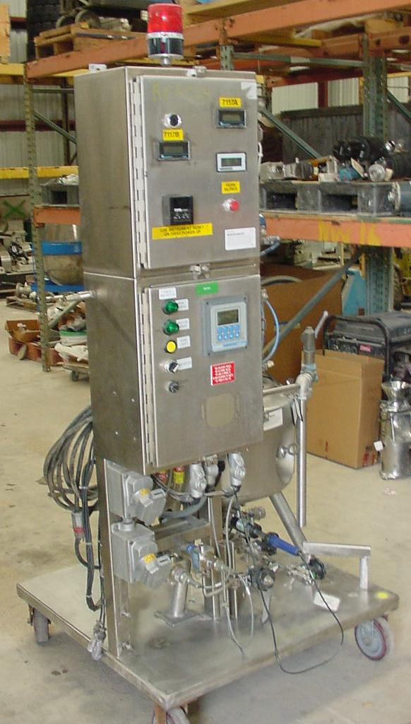 10 Gallon, Pilot Plant type reactor, Precision Stainless Sanitary reactor vessel. 316L Stainless Steel.  Unit rated 75/FV @ 350 F. internal and Jacket rated 100/FV @ 350 F. Has control panel with Rosemont mdl 54 control, top mounted level gauge, valves and more. Variable speed Lightnin model P6S05R top mounted mixer. Mixer shaft has 2 sets of blades. Mounted on portable stand on wheels 36