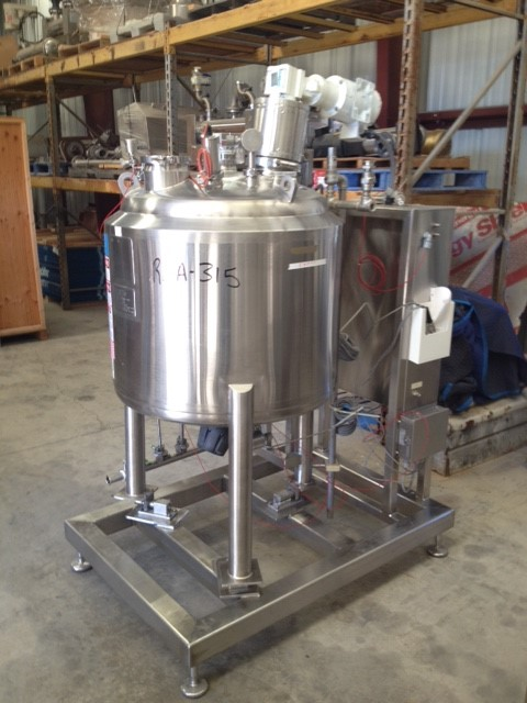 Used DCI, 90 Gallon (340 L) Sanitary Reactor.  Skid mounted with Load cells and control panel. Off center top entering agitator, approximate 1.25