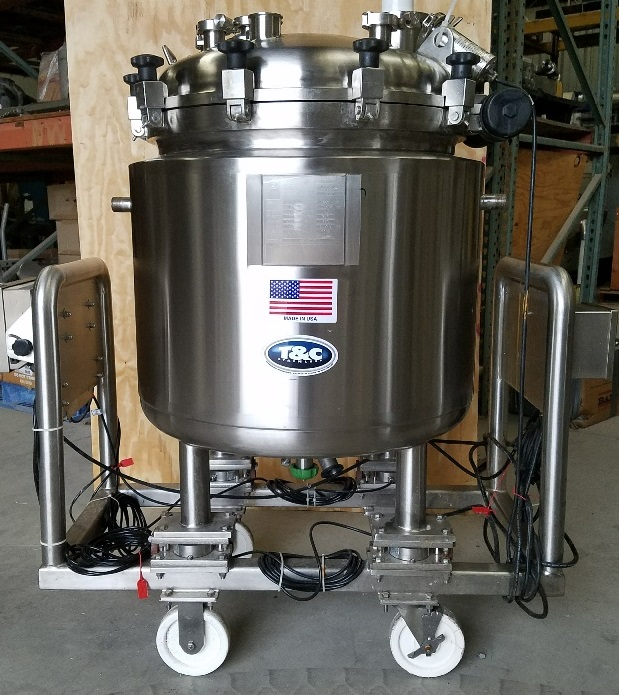 used 150 Liter (40 Gal.) Sanitary Stainless Steel Pharmaceutical Reactor/Fermenter.  316L Stainless Steel shell rated 60/Full Vacuum @ 350 Deg.F.  Jacket rated 60/FV @ 350 Deg.F.  Has clamp-on top with hinge.  Has bottom mount for magnetic mixer (mixer not included). Mounted on load cells with Mettler read-out. Includes light source. Unit is mounted on portable cart.