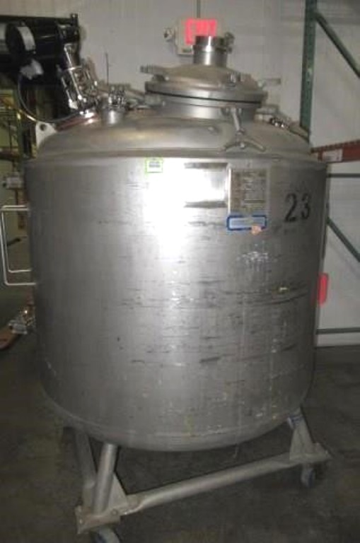 used 1000 Liter (264 Gal.) Stainless Steel Sanitary Pharmaceutical Grade Reactor. Jacketed Mixing Tank. Rated 40/Full Vacuum @ 300 Deg.F.. Jacket rated 100 PSI @ 300 Deg.F. Mounted on Wheels with Center Bottom Discharge, Agitator with 3/8 HP Motor 230V, Built by Apache/Precision Stainless Equipment.  Overall Dimensions: Approx. 80