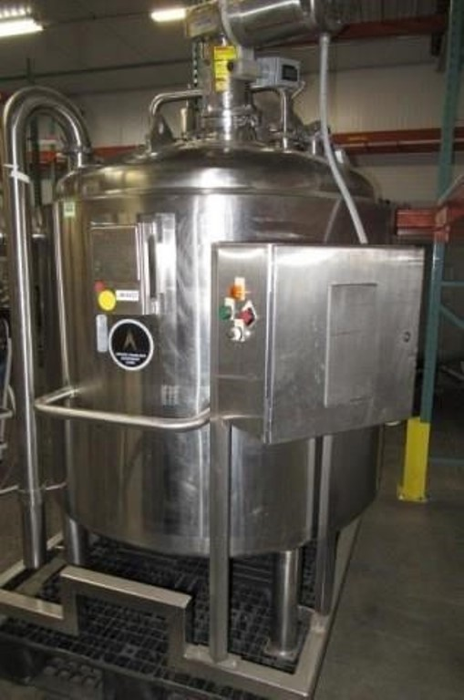 used 1000 Liter (264 Gal.) Stainless Steel Sanitary Pharmaceutical Grade Reactor. Jacketed Mixing Tank. Rated 40/Full Vacuum @ 300 Deg.F..  Jacket rated 100 PSI @ 300 Deg.F.. Bottom Discharge, Agitator  Lightnin SR5S50 Agitator with Stainless Steel 1/2 HP Motor 208-230/460V. Built by Apache Stainless Equipment.  Mounted on Stainless Steel Frame. SN# S/N 10938-1-2.  Overall Dimensions: Approx. 80