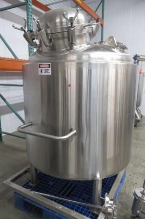 used 1000 Liter (264 Gal.) Stainless Steel Sanitary Pharmaceutical Grade Reactor. Jacketed Mixing Tank. Rated 40/Full Vacuum @ 300 Deg.F..  Jacket rated 100 PSI @ 300 Deg.F.. Bottom Discharge, Agitator  Lightnin SR5S50 Agitator with Stainless Steel 1/2 HP Motor 208-230/460V. Built by Apache Stainless Equipment.  Mounted on Stainless Steel Frame. SN# S/N 10938-1-1.  Overall Dimensions: Approx. 80