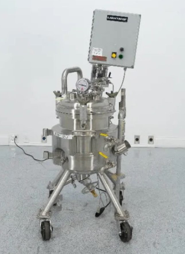 used 35 Liter (9 Gallon) Precision Stainless Sanitary Jacketed Reactor Vessel. Internal Rated 94 PSI @ 392 Deg.F., MDMT -20F @ 94 PSI.  Jacket Rated 187 PSI @ 392 Deg.F., MDMT -20F @ 197 PSI. SN# 4135-2,  Includes Lightnin Agitation, Est. Dims:32x32x64, Video of unit running available.