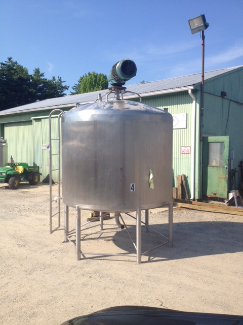 Used 1500 Gallon Stainless Steel Sanitary Mix tank built by APV Crepaco. 7' dia. x 5' T/T. Has 3/1.5 HP drive with 13.7/6.7 RPM output Top mounted Sweep mixer.  Cone bottom with dome top. Last used in Food plant.