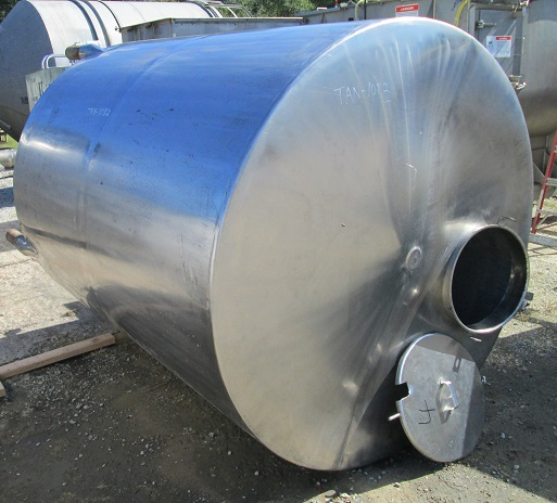 used 1200 Gallon Stainless Steel tank. Cone Bottom, Flat top with manway. 5'6