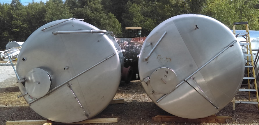 ***SOLD***(2) EACH used 2000 Gallon Stainless Steel tanks. Dish Bottom, Flat top with manway. 7' Dia. x 6'10