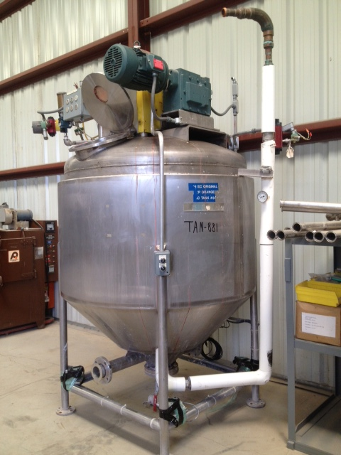 Used 500 Gallon Vacuum Mixing Kettle, Jacketed and equipped with Scraper agitation (sweep type) driven by 5 HP, 220/440 volt, 3 Phase, 1750 RPM input, 57 RPM output (30:1 gear ratio). Jacket Hydro-tested to 30 PSI. Sanitary construction. Dish top and Cone Bottom. Has actuator controlled top manway. 4'9