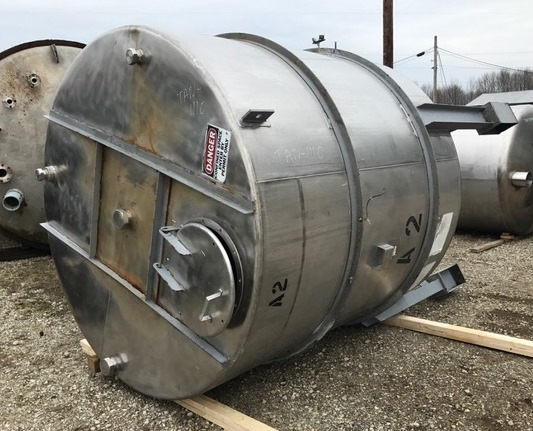 ***SOLD*** used 2000 Gallon Perry Stainless Steel Storage Tank. 7' dia. x 7' T/T.  11' OAH. Flat top and Cone bottom. Top openings: 2-2