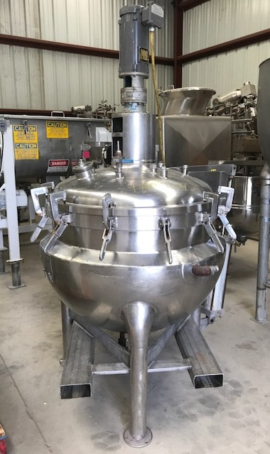 ***SOLD*** used 100 gallon Hamilton Jacketed Mix Vacuum Kettle, Style PC with Sweep Mixer with Baffle. Internal is Rated 15 PSI and Vacuum @ 312 Deg.F. Jacket rated 80 PSI @ 312 Deg.F.  Has sweep mixer.  Tilt out Dome top with swing bolts and cylinder assist lift off. Sweep Mixer is 1 HP, 208-230/460 volt, 1725 rpm, 56C frame, Explosion Proof motor into 17:1 gear reducer. Sanitary.  Kettle is approx 3' dia. x 7'6