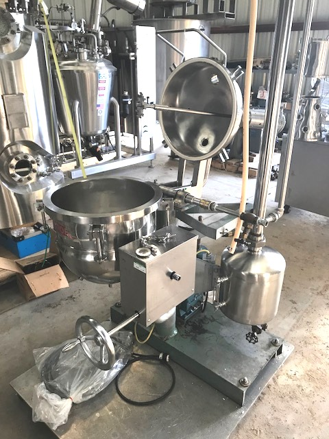 used 10 Gallon GROEN Vacuum Rated Tilting Kettle with Mixer. Sanitary 316SS.  Model DN/VA10. Rated Full Vacuum internal and 100 PSI @ 338 Deg.F. Jacket. Has quick clamp lid. Includes Kinney Vacuum Pump with 1/3 HP, 115/230 volt, 1 ph motor.  Mixer is Gast model 2AM-FCC-1 air driven.  Has removable High Shear Dispersion Blade. Unit is skid mounted on wheels. Skid dimensions 4' x 3'4