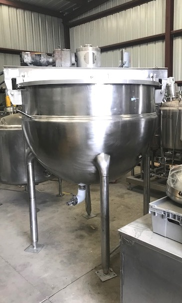 used 400 Gallon Hamilton Double Motion Jacketed Steam Mix Kettle/Tank. Has double motion agitator with scraper blades. Jacket rated 125 PSI @ 345 Deg.F. Style SA. NB # 2631. 2 HP, 208-230/460 volt, 1725 rpm, 56C frame. Tilt out mixer bridge.  Last used in food plant.
