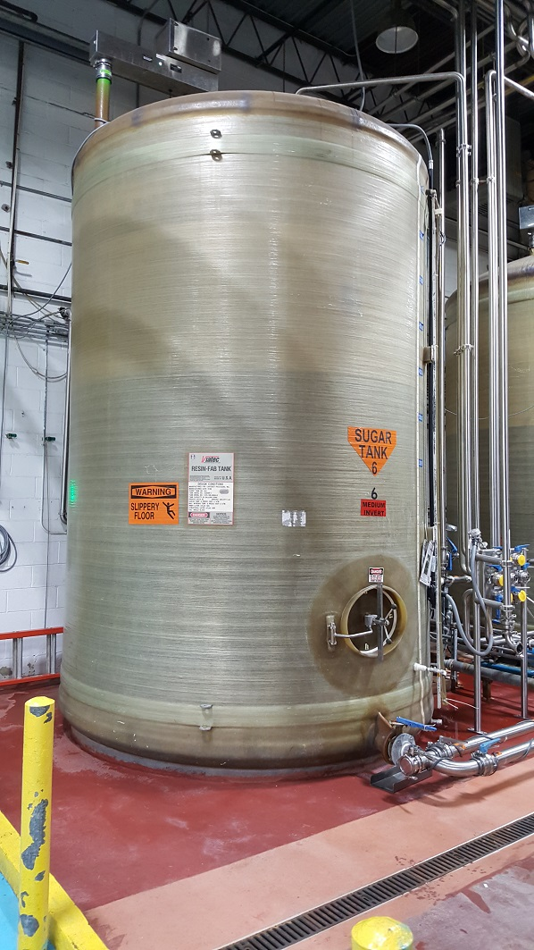 Qty (2): used 6,500 gallon FRP (fiberglass) storage tank. Dish top, flat bottom. 9' dia. x 13' T/T.  Built by Viatec Process Storage Systems (Resin-Fab Tank). Previously used in sanitary food and beverage plant as sugar holding tank. Side manway 20