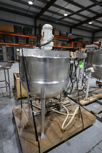 used Lee 100 Gallon jacketed Kettle with scrape agitation. Model 100D7-T, S/N B5443A, Jacket 90 PSI @ 322 F 140 PSI, NAT'L Board: 4882, Mounted on S/S Legs, with Top Mounted 1 HP, 230/460 volt motor into SEW gear reducer with 27 RPM output Agitation Motor.  Has mixer with tilt out bridge mixer with actuator assist. 2.5