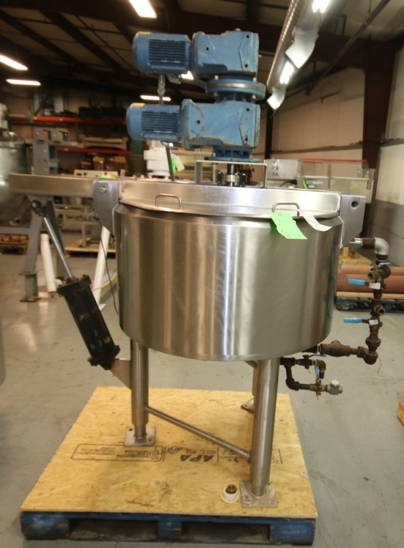 ***SOLD*** used 50 Gallon Double Motion Jacket Mix Kettle Built by Cherry Burrell. Aprox. 50 Gal. Double motion scrape surface agitation. Jacket rated 150 PSI @ 400 Deg.F. Hinged Lid Processor. S/N E-458-90.  Driven by SEW 1 hp @ 1760 rpm 230/460V, 3Ph Drive Motors, Pneumatic Bridge lift out assist. Sanitary. Unit is 3' dia. x 18