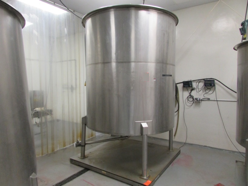 used 1500 Gallon Stainless Steel Sanitary Mix Tank. Cone Bottom Tank with (4) Stainless Steel Legs, Neptune JG-6.1 1/2HP Clamp On Mixer with Stainless Steel Shaft and Prop, 350 RPM output. 6'2