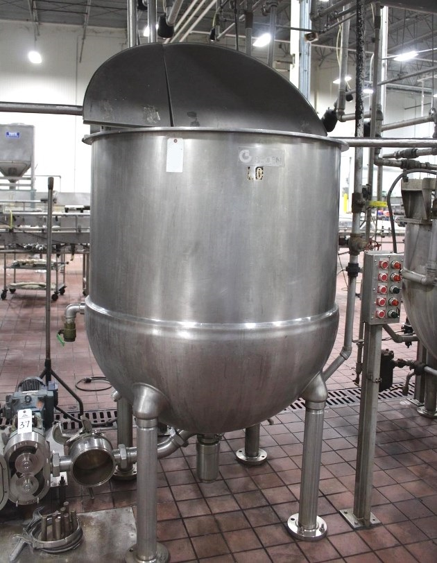 used 300 Gallon Groen Jacketed Mix Kettle with Double Motion/Twin Action Inclined Scrape Surface agitation. 30 rpm Scrape Surface Agitator with 68 rpm Secondary Paddle Agitator. Has a 5 HP and 2 HP motor. Jacket rated 100 PSI @ 338 Deg.F. 3