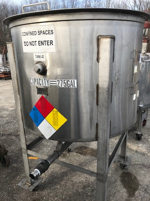 used 275 gallon portable Stainless Steel tank. Flat top with hinged lids, Cone bottom.  Mounted on wheels. 3'11