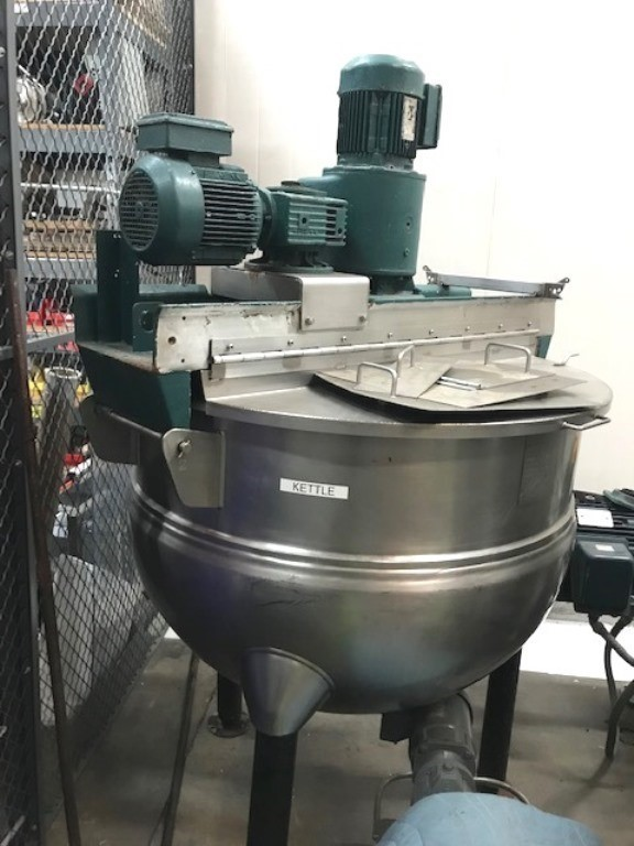 ***SOLD*** Used 150 gallon Hamilton Dual Motion Jacketed Mix Kettle.  Model SA stainless steel hemispherical bottom.  Jacket rated 125 psi @ 345 Deg.F..  Dual hinged covers.  Bridge mounted tilt out agitators.  1.5 Hp sweep agitator with scraper blades.  2 Hp high speed