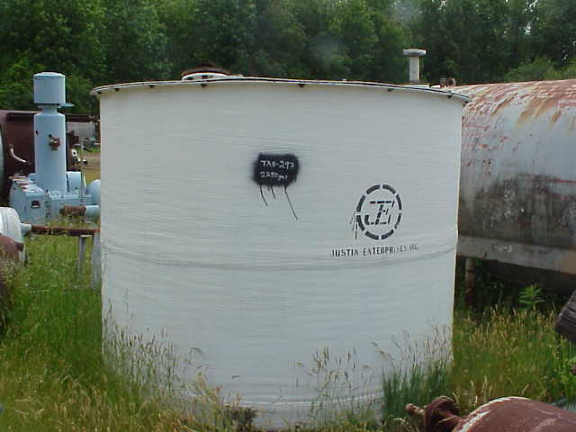 2250 Gallon Fiberglass,FRP Tank.  Flat top and flat bottom.  Internal coils.  Has agitator, No drive.