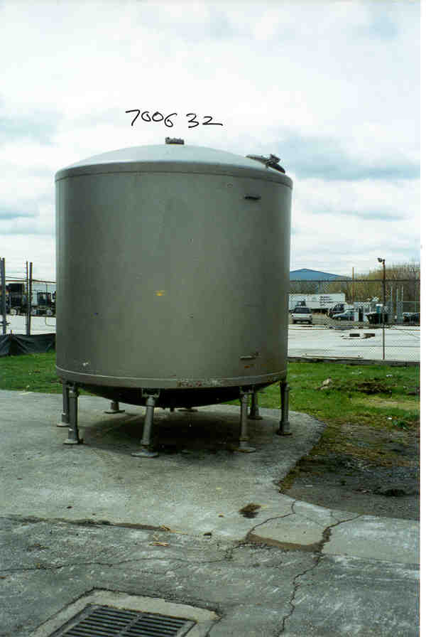 5000 Gallon Glass Lined Carbon Steel tank. Vertical, mounted on (8) pipe legs.  Order # 18832.  No name plate.  Visual