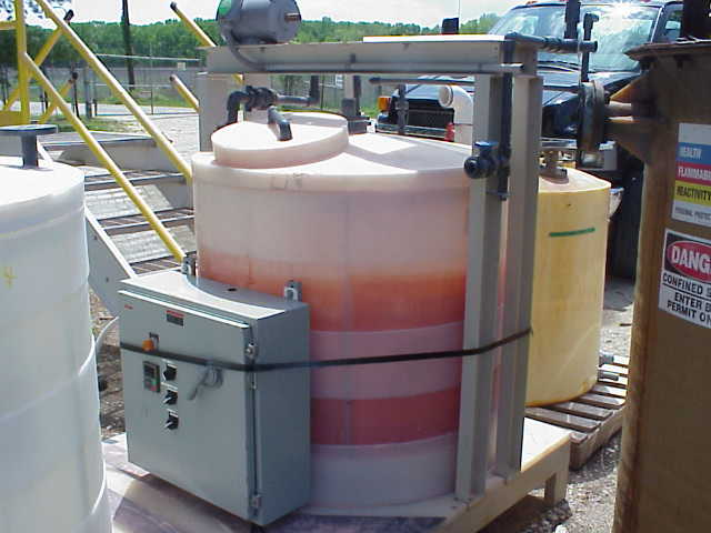 200 gallon Poly tank with mixer/agitator.  Skid mounted with control panel.