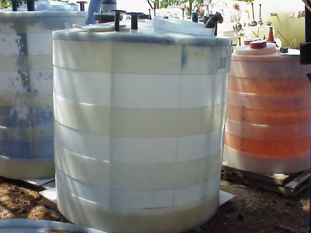 675 gallon Poly tank.  With mixer/agitator.