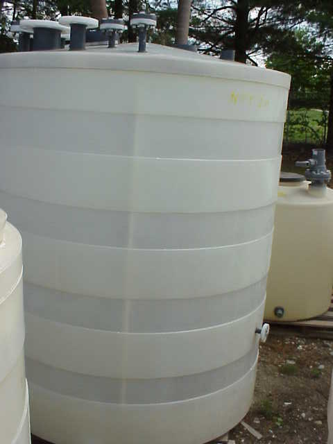 750 gallon Poly tank.  With (2) mixer/agitator.