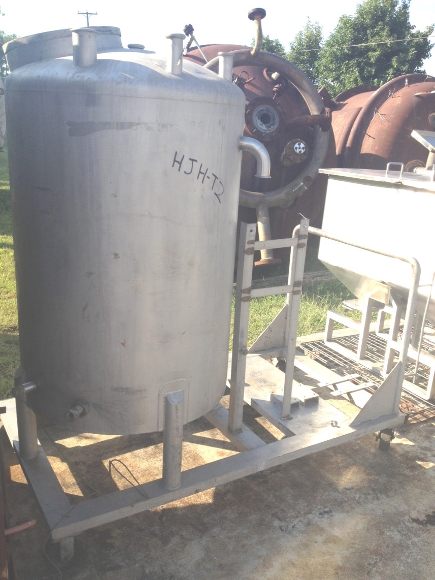 200 gallon Stainless Steel Tank.  3'dia. x 4' T/T.  Dish top and Slope bottom. Has several openings including 2