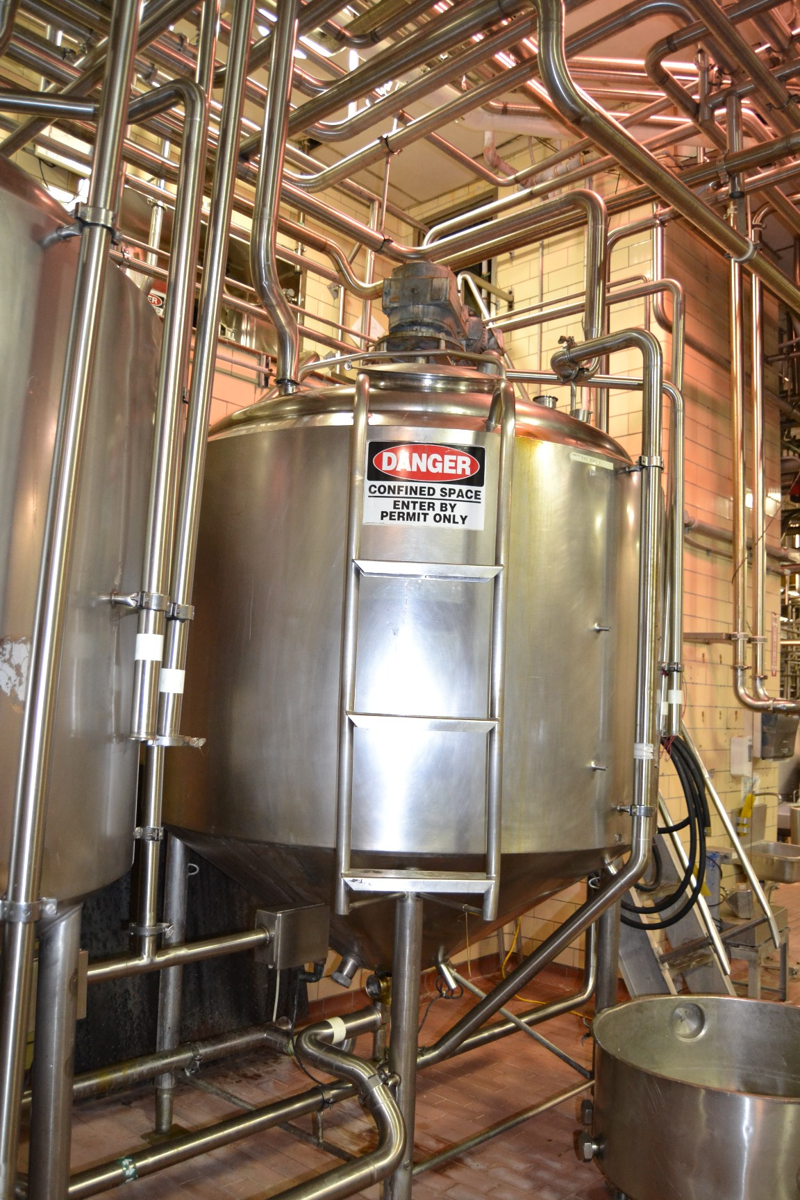 used 800 Gallon Crepaco Jacketed Mix tank/processor kettle with Sweep agitation. Jacket rated 50 PSI. Dish top and Cone Bottom. Drive is dual HP: 2 HP 1740 rpm, 230 volt/ 1HP, 870 rpm, 230 volt into Reliance gearbox rated 14/7 rpm output. Has baffle and spray ball. Approx. 7' OD x 10' OAH without mixer drive.  Last used in food plant in sanitary application.