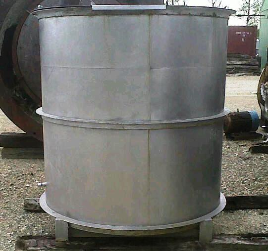Approx. 750 gallon stainless steel mix tank/ storage tank.  5' diameter x 5' straight side.  Has agitator shaft and blades, no drive.  Flat open top with hinged lids on each side.  Slight cone bottom with ~ 3