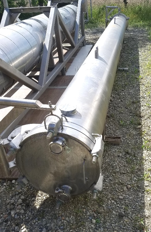 used 690 Sq.Ft. Shell and Tube Heat Exchanger. Enerquip Sanitary 304L Stainless Steel. TUBES: Approx (178) 3/4