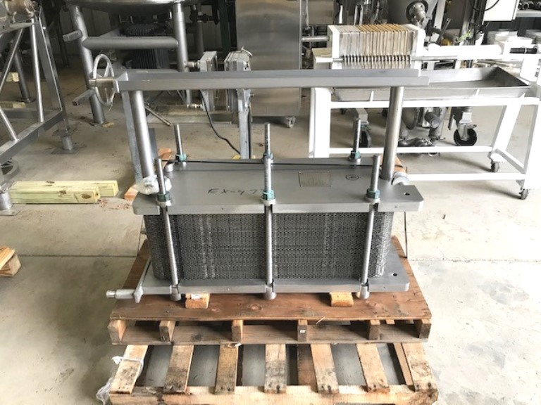 used Mueller 250 Sq.Ft. Sanitary Plate Heat Exchanger, Model AT20SS F-10. S/N 223807 Rated 100 PSI @ 150 Deg.F.  1-Section with Aprox. (82) 1' x 3' Stainless Steel Plates. Sq.Ft. is approximate.  Overall Dims.: Aprox. 49