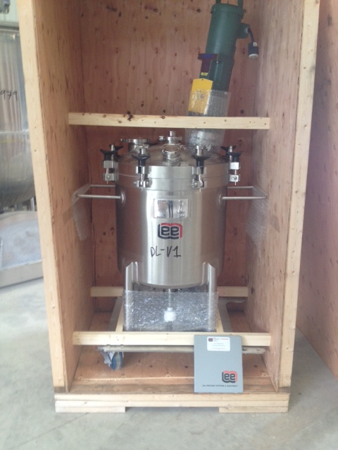 UNUSED LEE 200 Liter (50 Gallon) Mixing Vessel. Rated 50 PSI @ 300 Deg.F. NB # 10009. 316 Stainless Steel. Has Lightning model X5S25, 1/4 HP, 350 RPM, 230 volt, 3 ph mixer. 20 Ra finish. Has removable head with swing clamps.  Mounted on Stainless steel cart on wheels. Sanitary vessel.