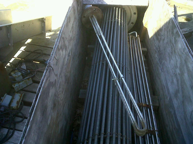Electric Heat exchanger/tank heater.  Stainless Steel tubes.  Approx. 3 sqft surface area.  Has (3 u-tubes (6 total holes) x 1/2