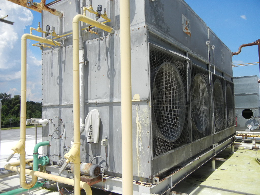 (2) Each used FRICK model Evaporative Coolers/Condensers. Model AFC350. S/N AFC84047 and 48. Rated 50 PSI. Overall dimensions 12' ht. x 9'4