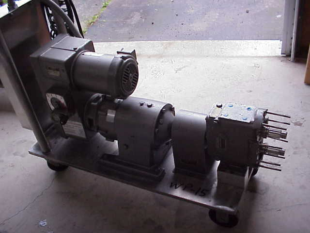(1) Stainless Steel, rotary lobe, Waukesha Sanitary Pump.  Model 30.  Vari-drive (varible speed) motor, 2 HP, 230/460 V, 1725 RPMi, 425 - 4275 RPMo, max torque 72 in/lbs,   Has Square D control panel.  Portable on wheels.  Missing head.  (can be sold in parts, Waukesha Parts)