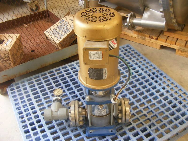 Goulds SSV Vertical Stainless Steel in line pump. Size 4SVD1J9BO.  Driven by a 5 HP. 230/460, 3470 rpm motor.