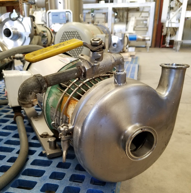 TRI CLOVER sanitary centrifugal pump Model C216MD18T-S driven by 5 HP, 3450 RPM.  Stainless Steel. Previously used in sanitary food and beverage plant.