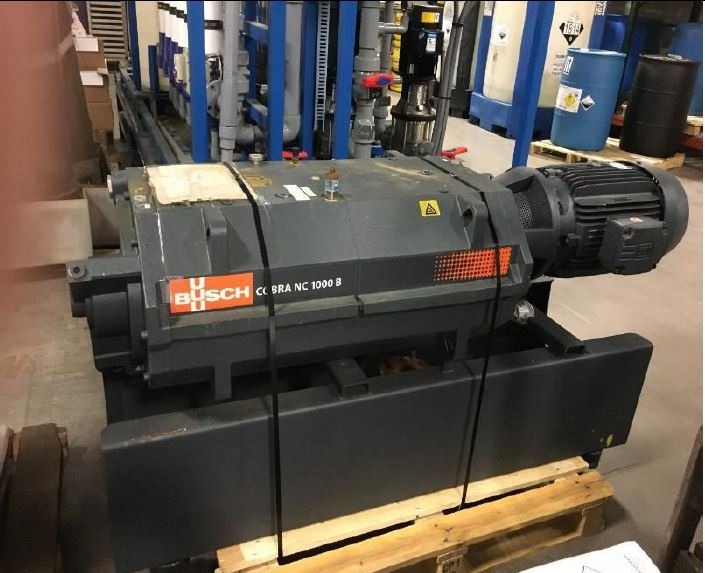 Busch Vacuum Pump model 1000NCB. Screw Vacuum pump. 590 ACFM.  0.075 Torr. 40 HP. Unit hooked up but never started due to plant shut down.