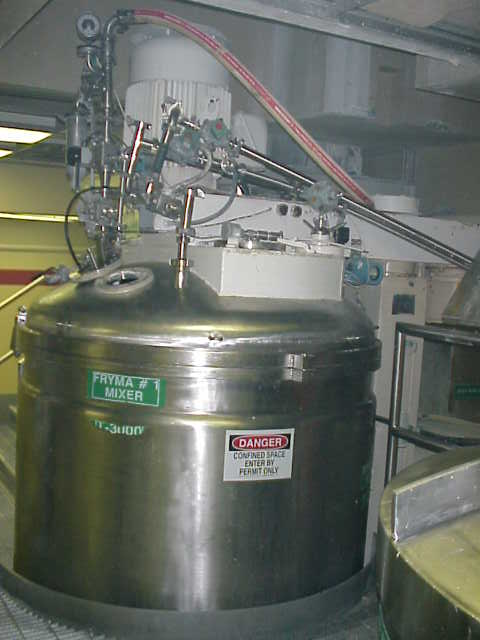 used 2400 liter Fryma VME-2400 Vacuum Processing Vessel, Sanitary construction, 2400 Liter (630 Gallon) working capacity. Working temperatures are 150 Deg.C (302 Deg.F.)for the interior and the jacket. The interior has a pressure rating of -1/+1 bar and the jacket has a 2.5 bar rating. There are two agitator drives. A 7.5 hp motor drives a center 3 blade counter rotating agitator and a scrape agitator through a chain drive. A 50 hp motor drives a disperser type agitator off to the side of the center shaft. The top has an 8