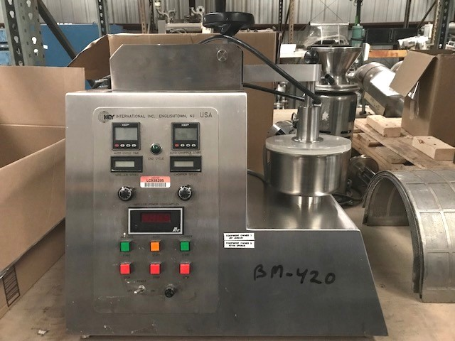 used Key International Bench Top High Shear Granulator Mixer Model KG-5. S/N: JI-3728. Comes with 2 choppers, (2) 1 Liter bowls and (1) 3 Liter Bowl. Last used in Pharmaceutical application.
