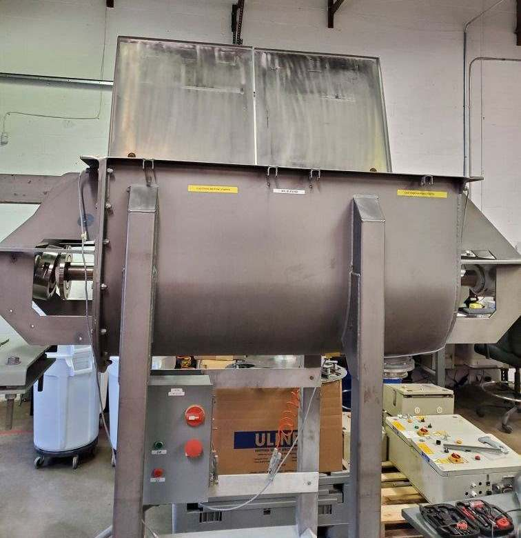 used 10 CU.FT. Sanitary Stainless Steel Ribbon Blender built by Hayes & Stolz. Model HR10-0199SSS, serial#A100801. 304 stainless steel 10 gauge Interior surfaces polished to 180 grit finish.  Exterior surface glass bead blasted finish. 44in x 22in x 26in deep. Split shaft seals with CINCH SEAL GASKET system. 6in discharge port with Salina vortex gate. Two piece Stainless steel split cover with safety grid. 5-HP, 3 phase, 60 cycle, 230/460 volt motor. Control panel with motor starter