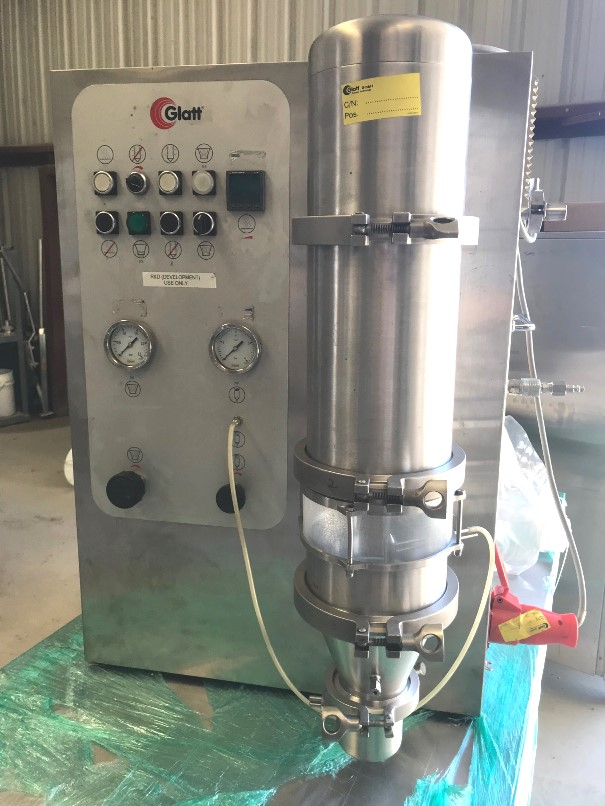 used Glatt Mini-Glatt 3 Fluid Bed Dryer. Sanitary. Units used for Drying, Granulating, Agglomerating, Coating and bottom / top spray process. Batch size: 25 g - 375 g. Output: Cubic feet: 565 per hour. Air consumption: 6 bar. 16 cubic meter per hour at 6 bar air consumption. Stainless steel construction.