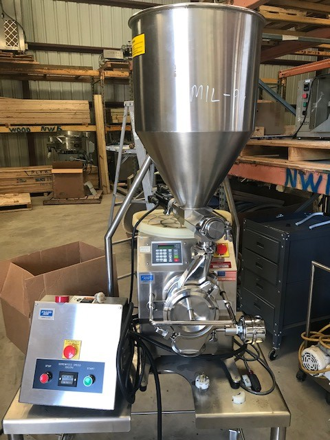 ***SOLD*** used Fluid Air Granumill Jr. with Screw Feeder. 120 Volt Single Phase for screw.  Mill is 1 phase 240 volt.  Rated throughput 0.1-25 KG/HR.  Last used in Sanitary Pharmaceutical plant.