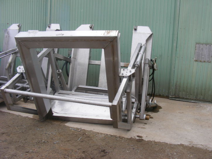 (1) Hydraulic Stainless Steel Tote Bin/Box Dumper/Feeder.  Last used in food plant.  Fits Totes/Boxes that are approximately 52