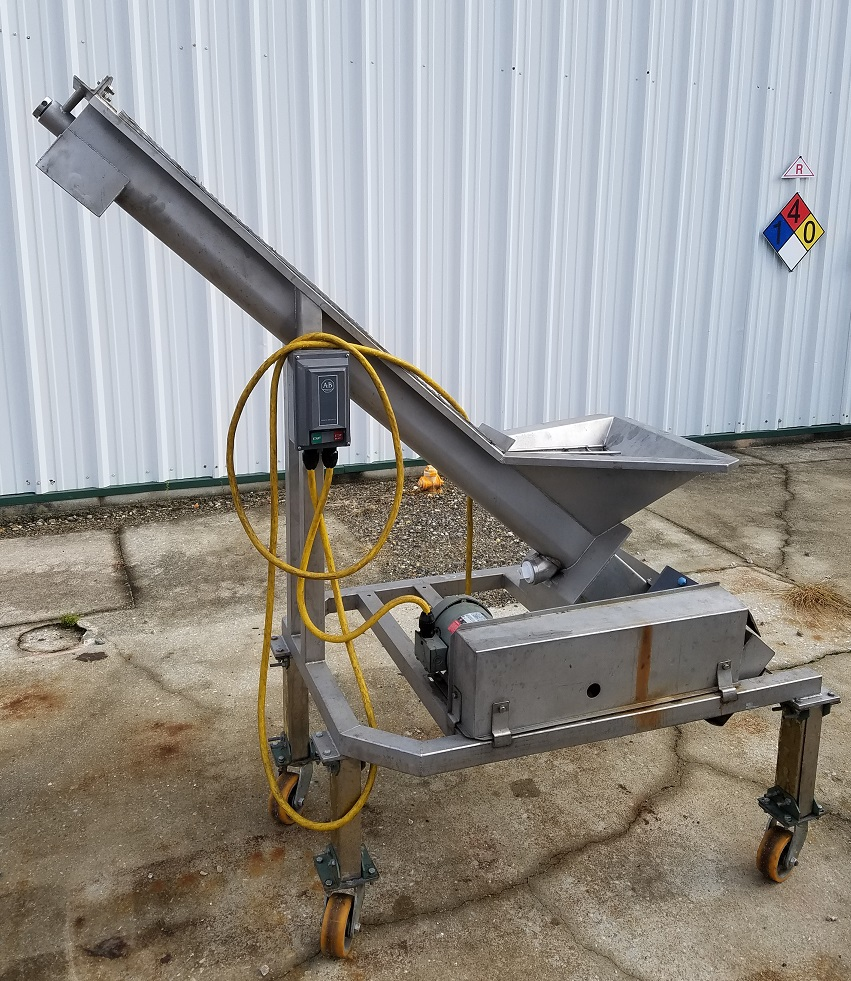 Used inclined screw conveyor. Stainless Steel, portable on wheels.  Screw 4